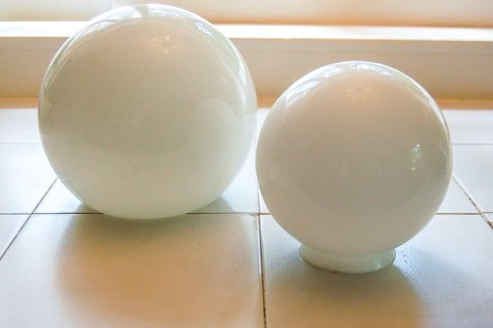 Opaque round glass shades.
