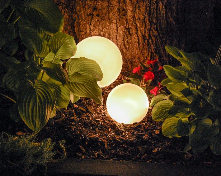 Glowing outdoor orbs at  night.