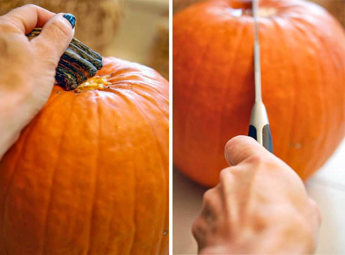 Cracking stem off of pie pumpkin to the left of photograph and slicing through the centre of the pumpkin with a chef's knife to the right.