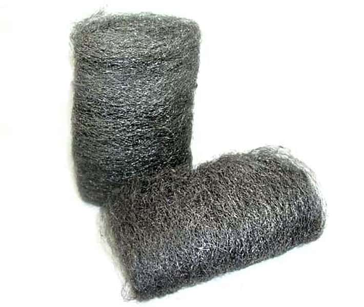 Two big pads of fine steel wool on a white background.