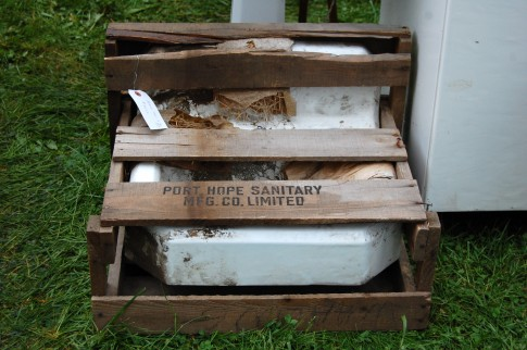 A vintage sink still in its wooden packing crate.