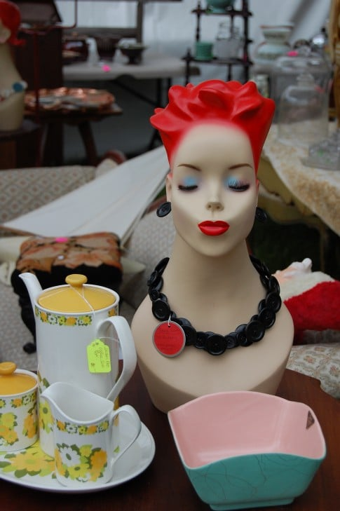 Very cool button necklace on mannequin.