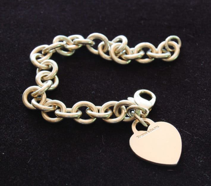 After picture of silver bracelet with heart charm post cleaning with silver dip.