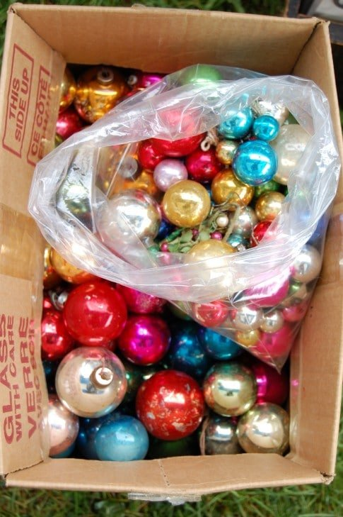 A big box of balls. If they're unique, antique/vintage Christmas balls are expensive. The regular old round variety however are fairly inexpensive. This whole cardboard box filled with multicoloured glass Christmas balls was $10.