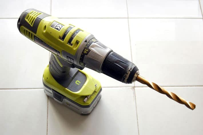 Cordless Ryobi drill with 7/16ths drill bit in it for tapping a maple tree.
