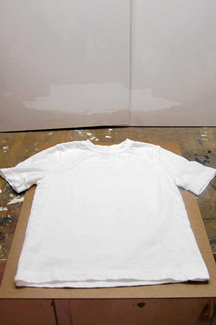 White t shirt laid out on workbench ready to screen print.