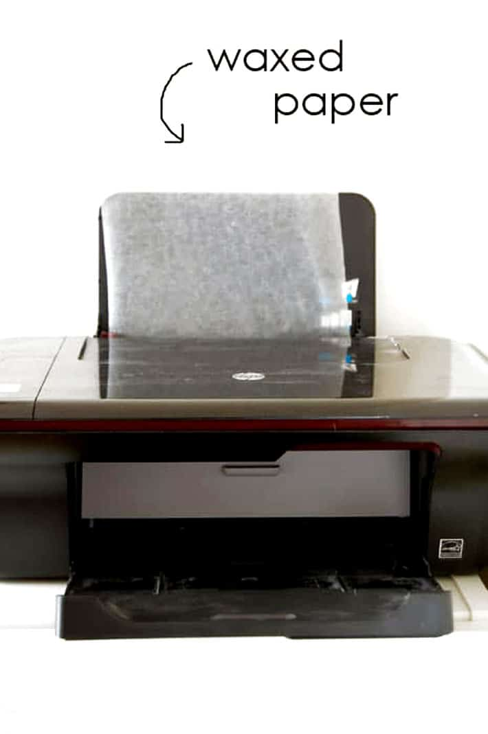 Inkjet printer with wax paper fed into it.