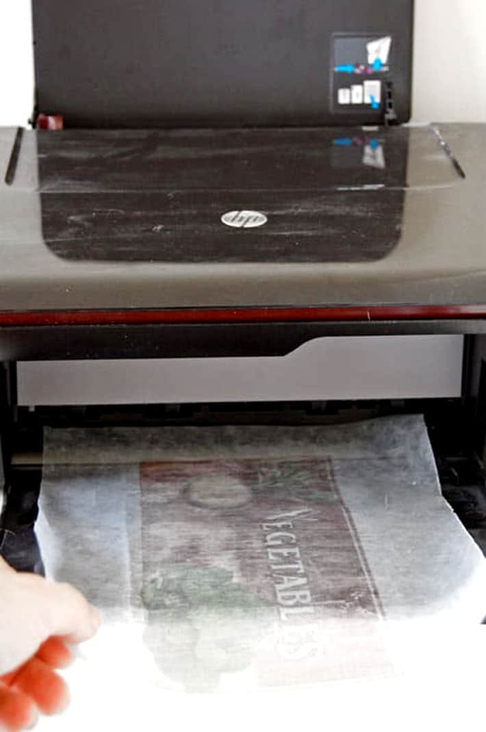 Printed wax paper coming out of inkjet printer.