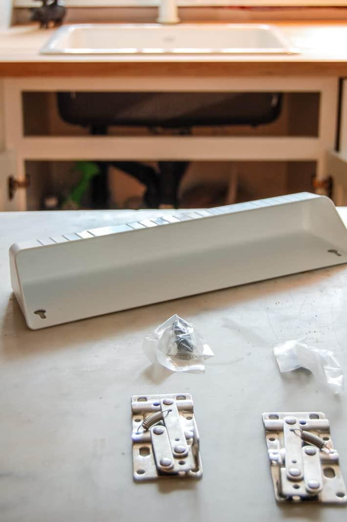 Rev-A-Shelf tip out tray kit.