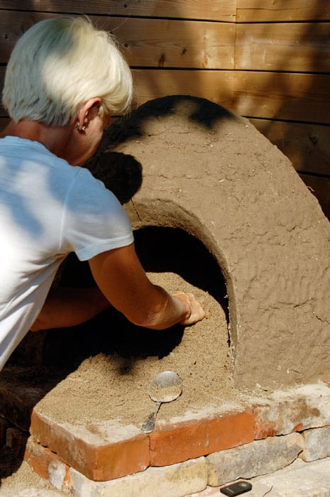 digging-out-sand-cob-oven