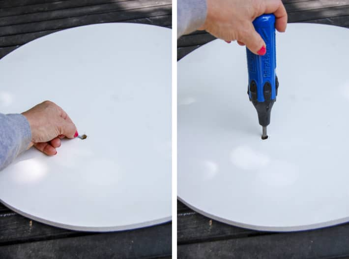 Attaching a DIY lazy susan to a tabletop by dropping a screw into the access hole and then screwing it in through the access hole.