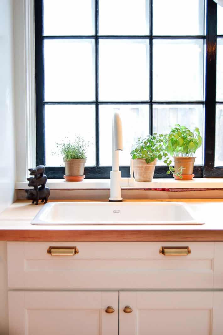 White Martha Stewart shaker style cabinets.