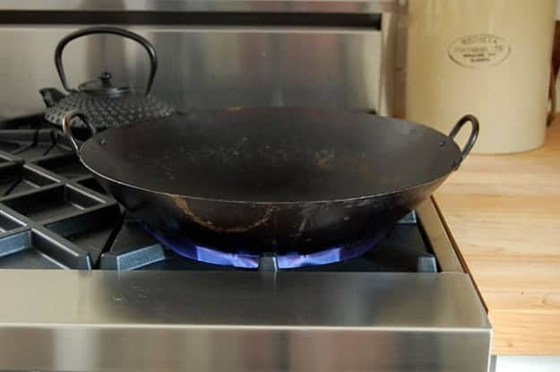 Cooking With Wok On Blue Star