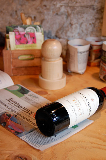 "Rolling wine bottle over a 7"" strip of newspaper."