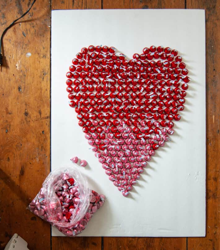 Hershey's kisses arranged on foam core board in the shape of a heart.