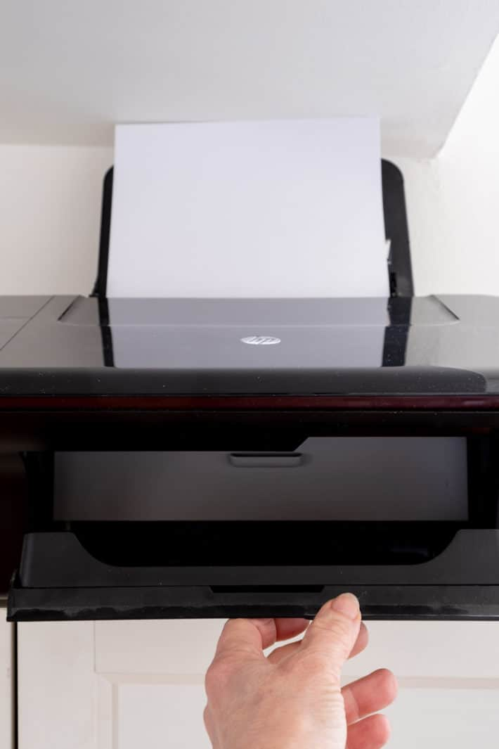 Opening outer door that paper spits out onto of HP inkjet 3050 printer.