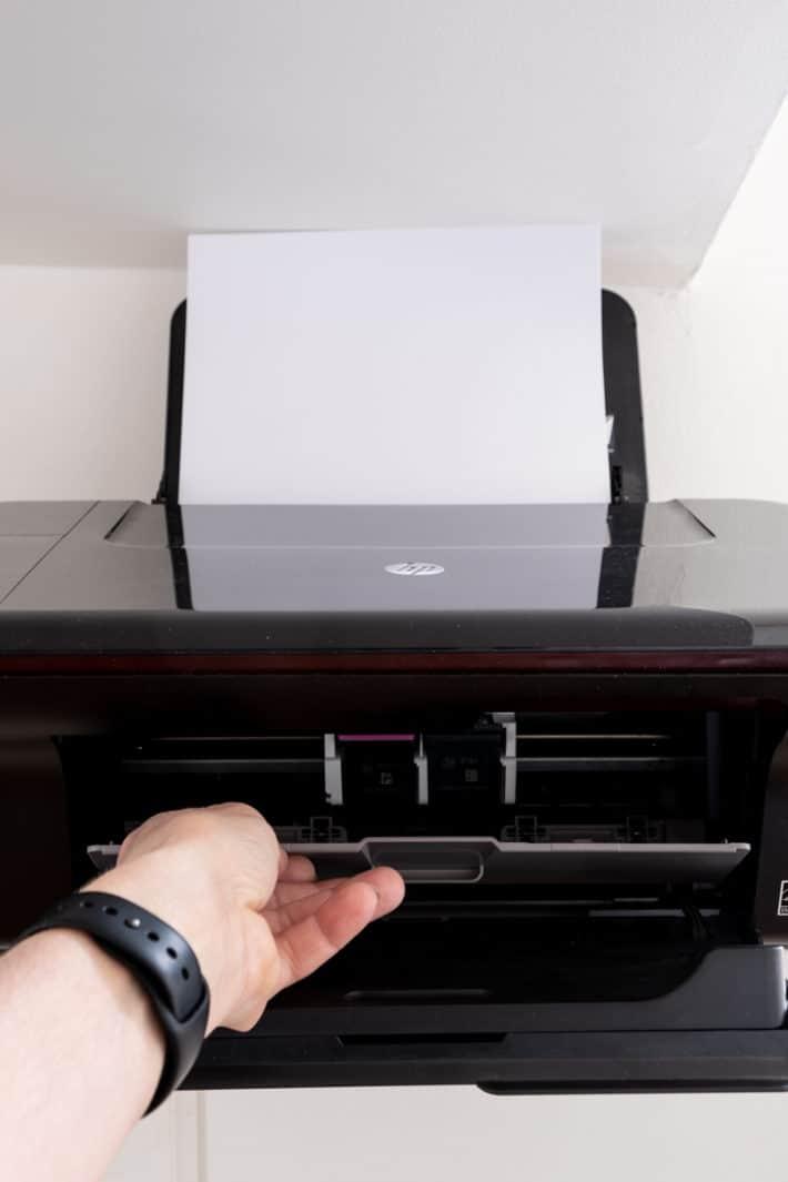 Opening inner door of printer to access printer cartridges.