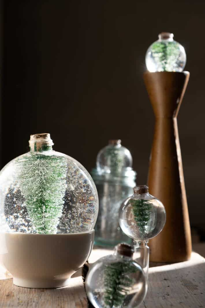 DIY snow globes with their corks drying overnight.