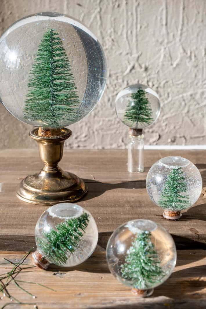Beautiful classic Christmas snow globe with bottle brush trees inside in various sizes.
