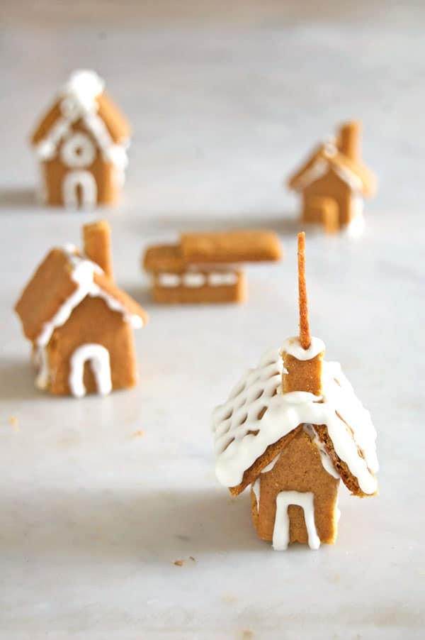 Collection of tiny gingerbread houses and churches.