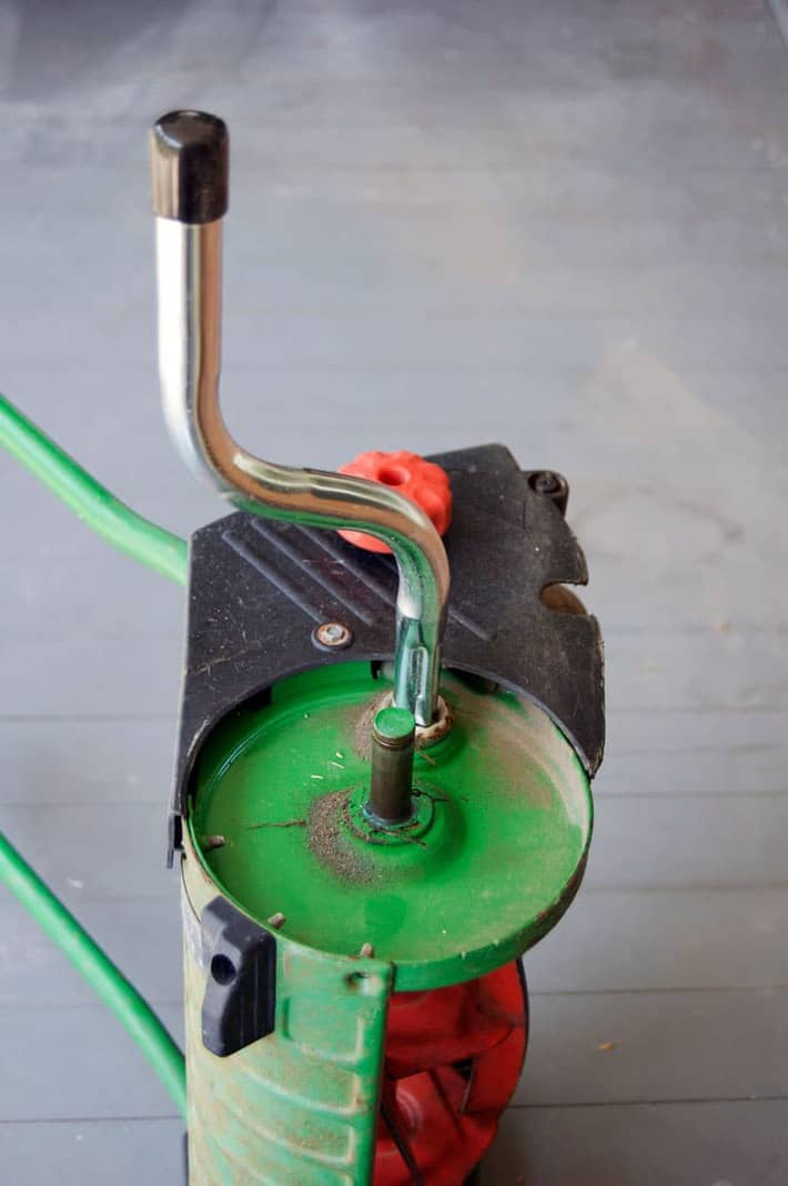 Hand crank attached to a push mower ready to sharpen.