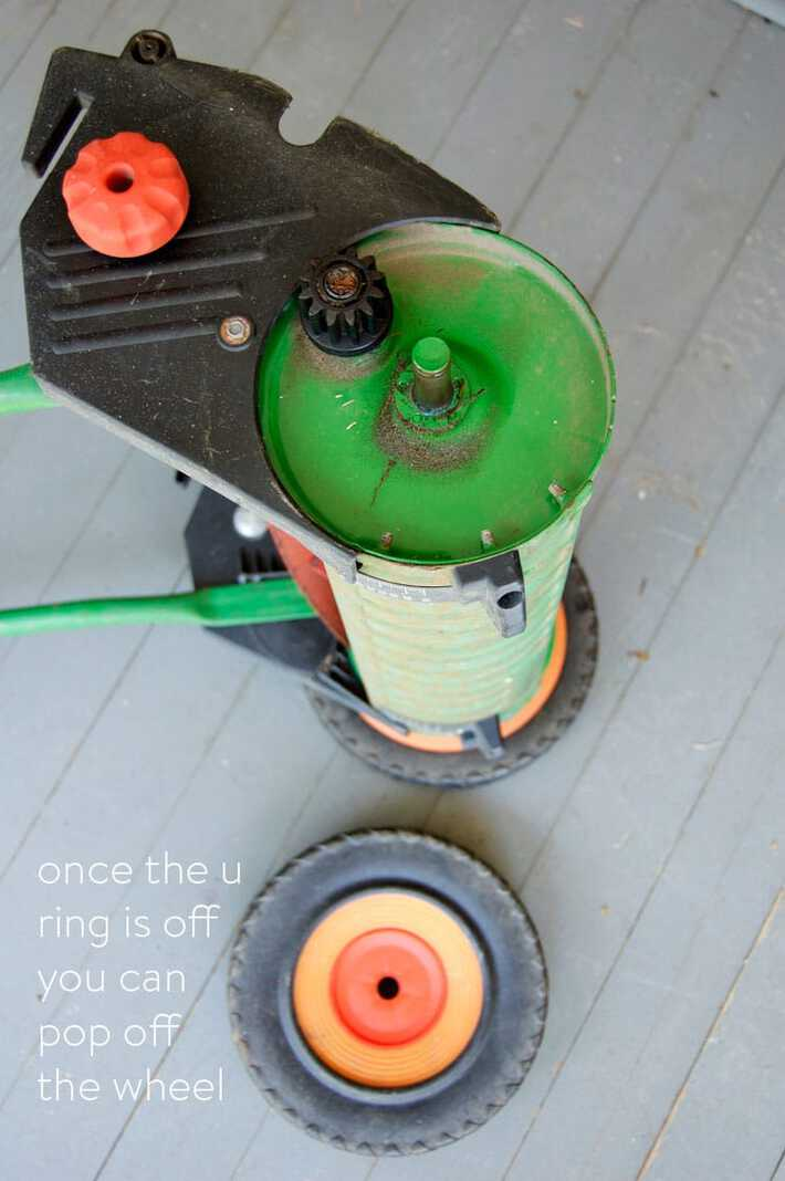 removing-wheel-from-push-mower