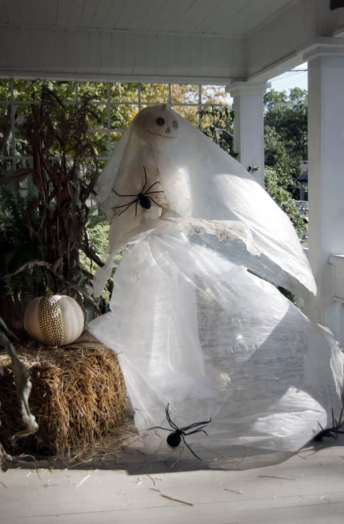 Life sized ghost bride blowing on front porch.