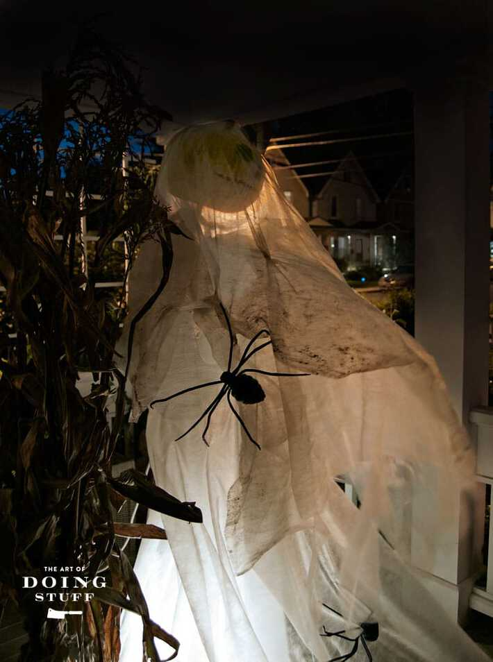 White DIY halloween ghost decoration blowing in the wind.