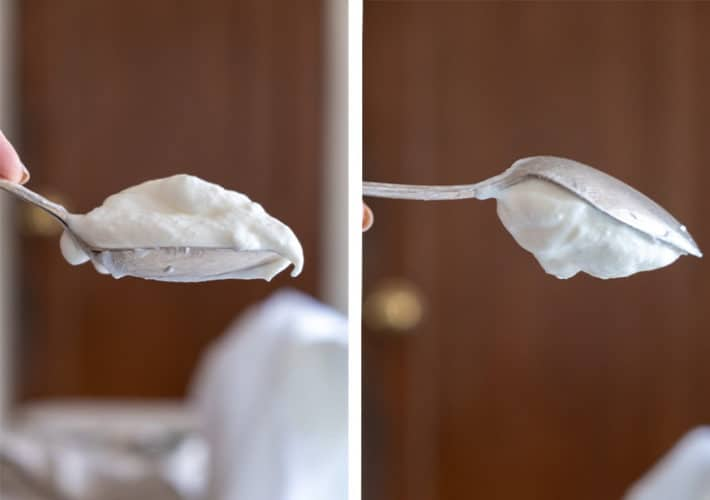 Strained Greek yogurt sits high on a spoon on the left and to the right the same spoon held upside down with yogurt staying put.