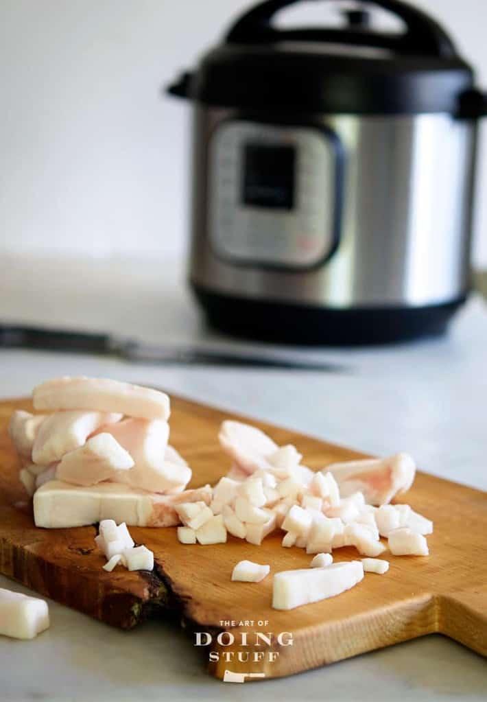 Pork fat being prepared to render into lard.