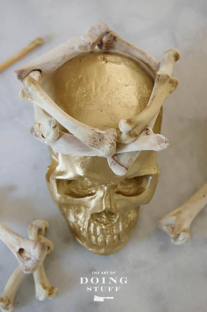 Looking down on gold skull wearing a crown.