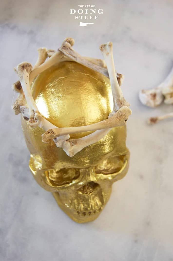 A gold Halloween skull on a marble table.