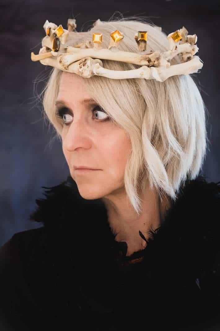 Karen Bertelsen wearing crown of bones.