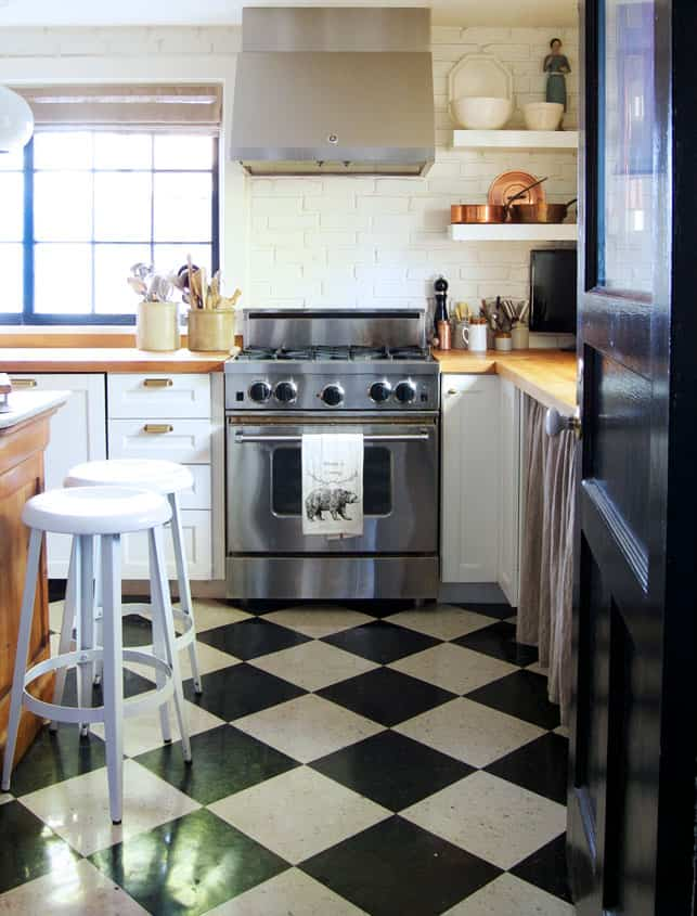 Black and white checked VCT tile in a modern country kitchen with Blue Star range.