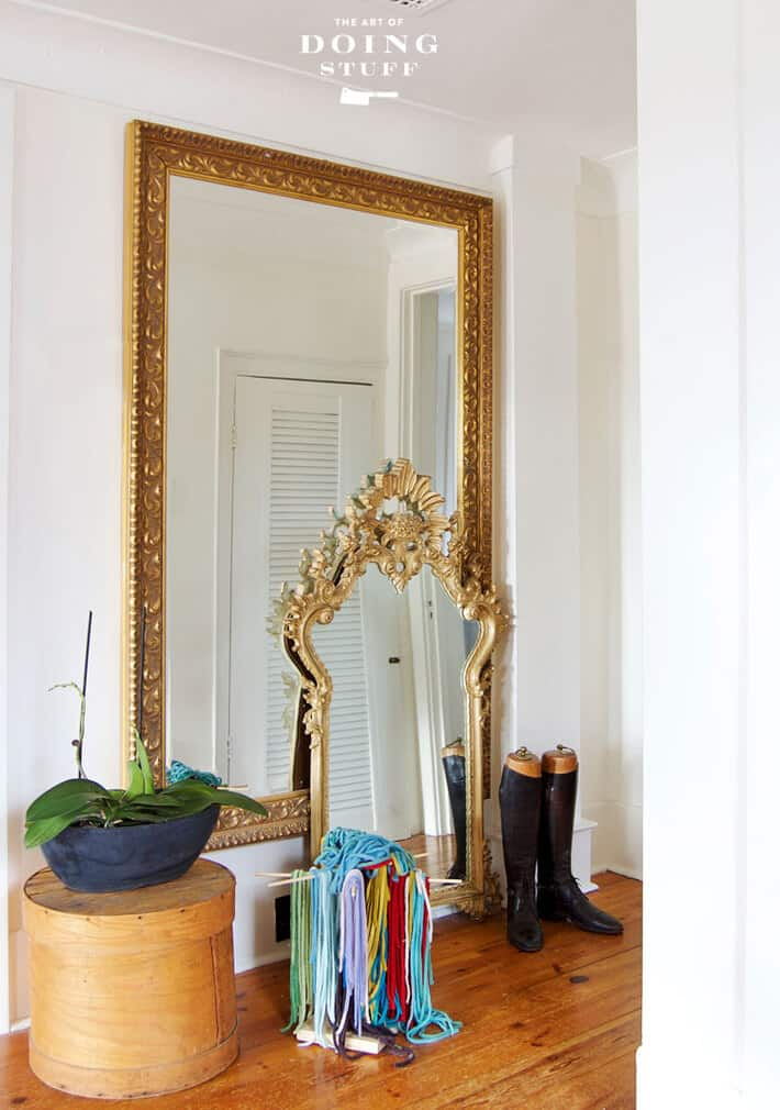 Decorating with ornate gold mirrors.
