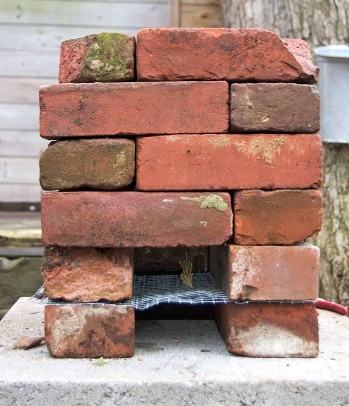 6 layers of stacked bricks forming a rocket stove.