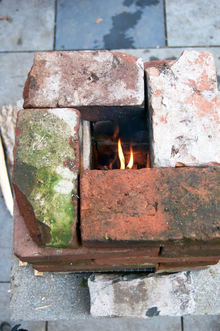A look down the chimney in a burning brick rocket stove.