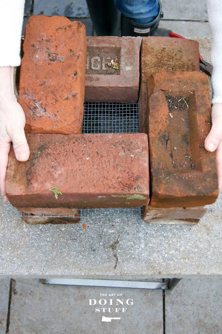 Assembling a rocket stove in 10 minutes with the 3rd layer of bricks.