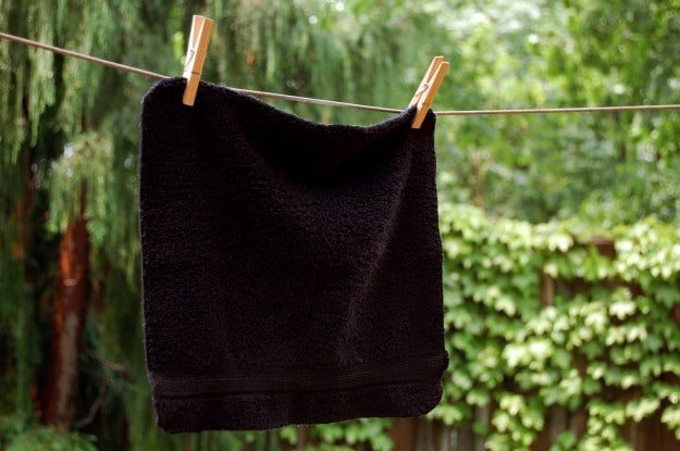 Black facecloth on clothesline.