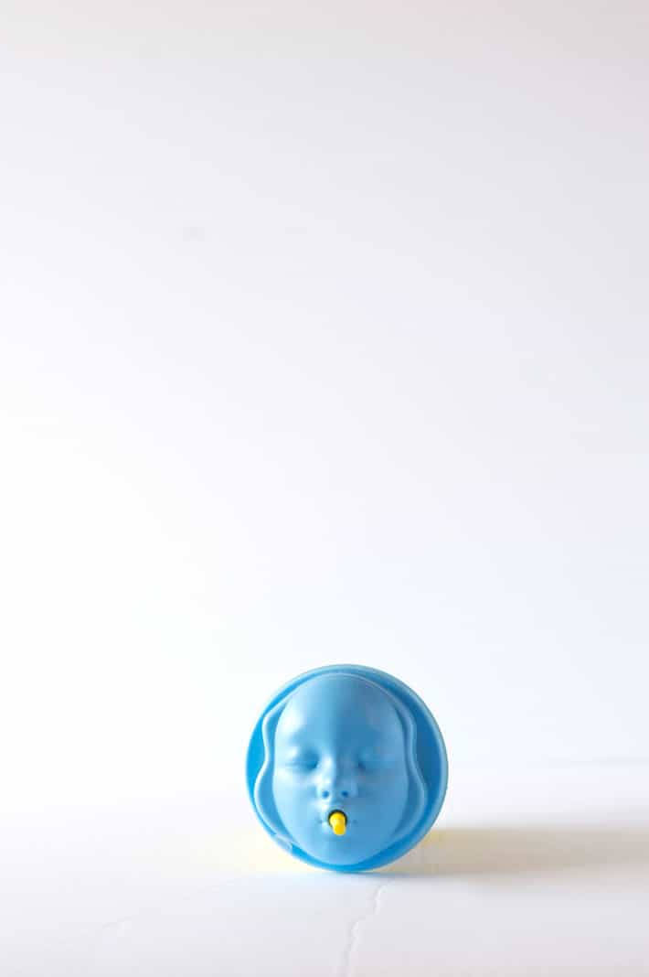Head on shot of the weird blue plastic face lid for paper cup. Looks similar to a kid's sippy cup.