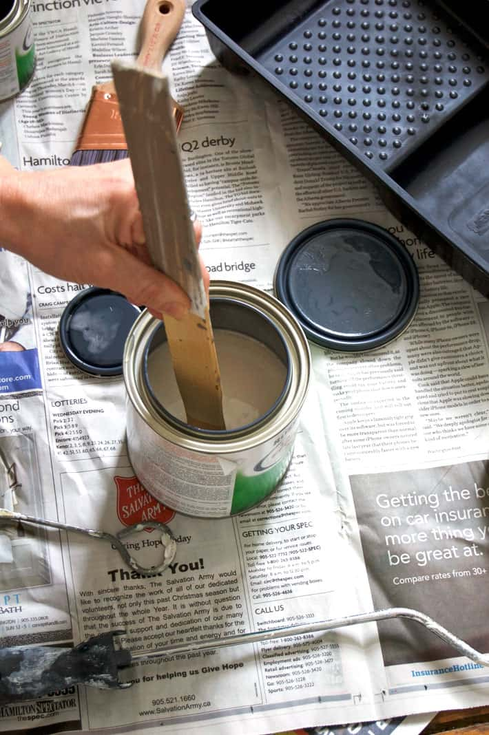 Mixing activator and paint together with an old paint stick.