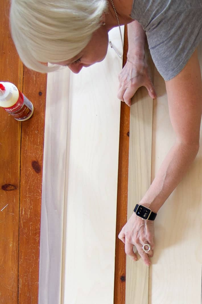 """Placing 3"""" wood trim on birch plywood for interior shutters."""