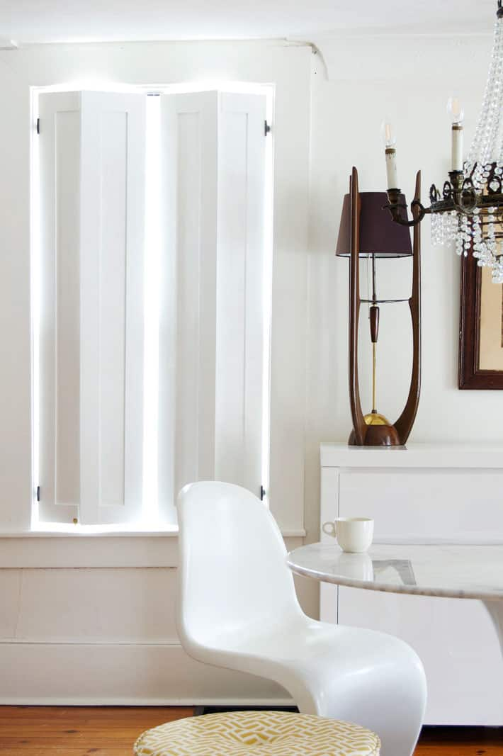Clean looking shaker style interior shutters in elegant historic home.