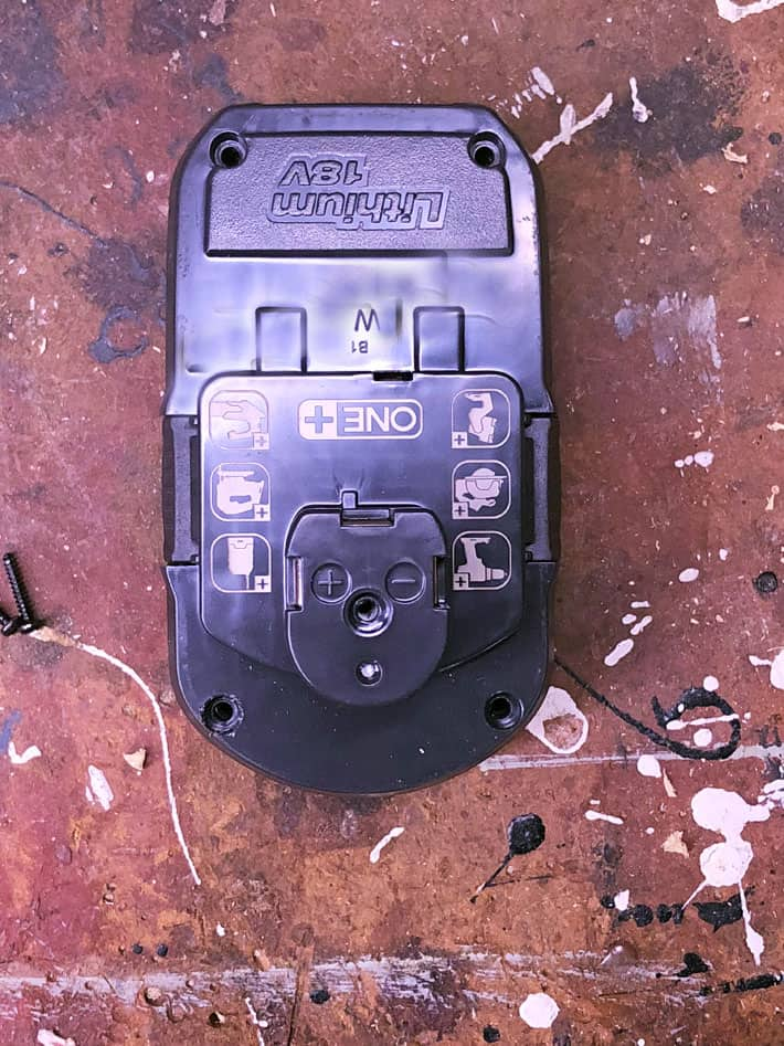 Overhead shot of Ryobi 18 volt lithium ion battery.