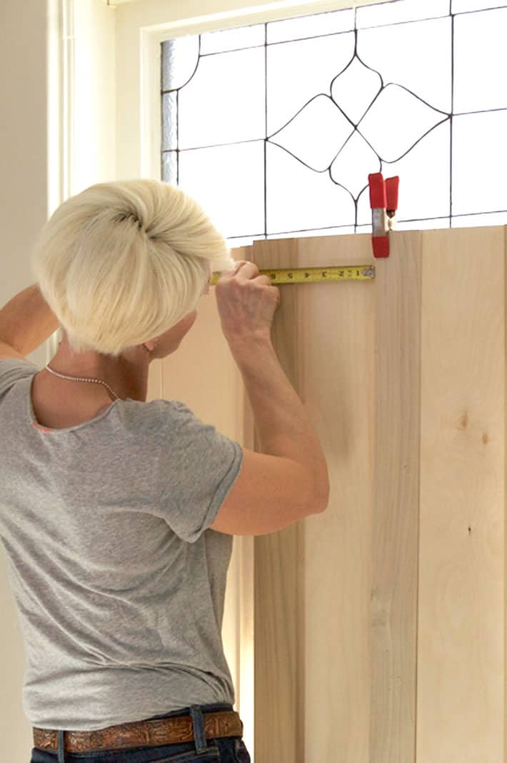 Measuring for trim on interior shutters.
