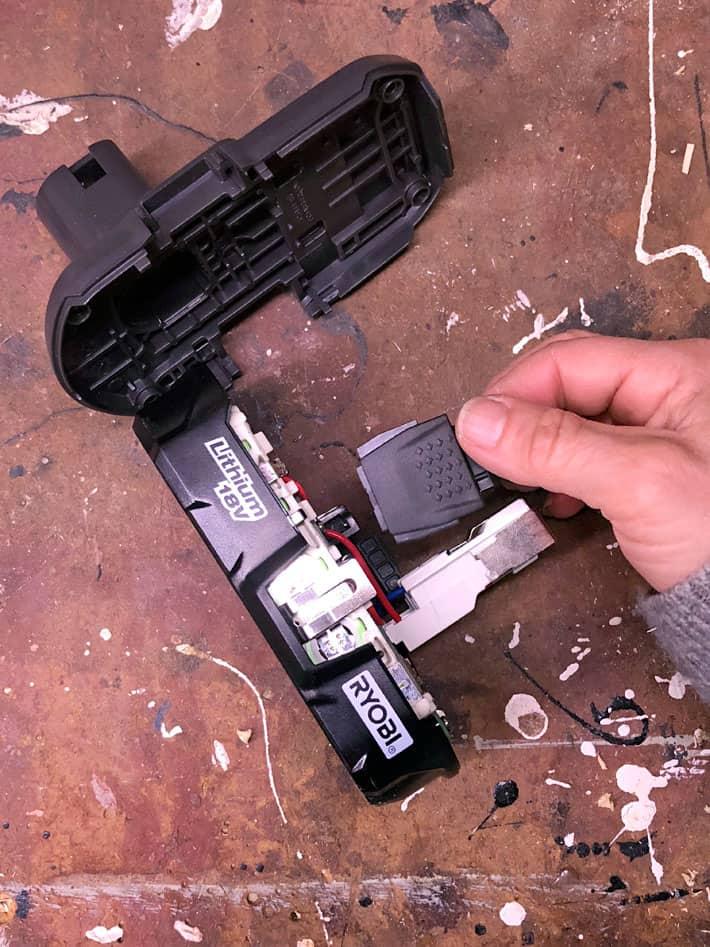 Removing sides of ryobi battery.