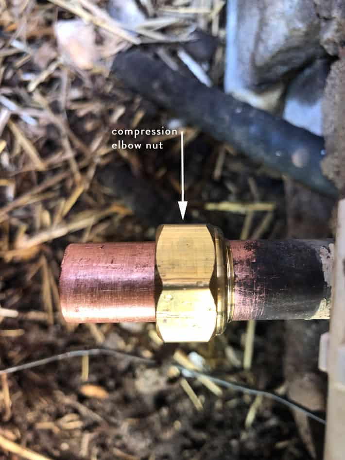 Compression fitting nut slid onto old copper pipe prior to repair.
