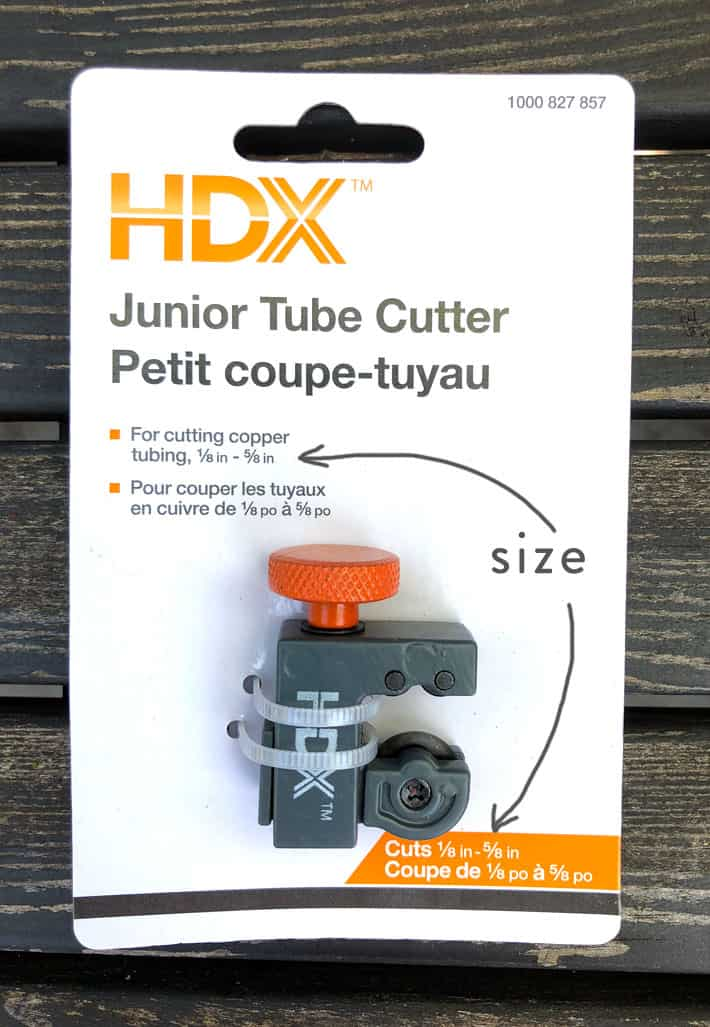 Brand new grey and orange pipe cutter in it's packaging.
