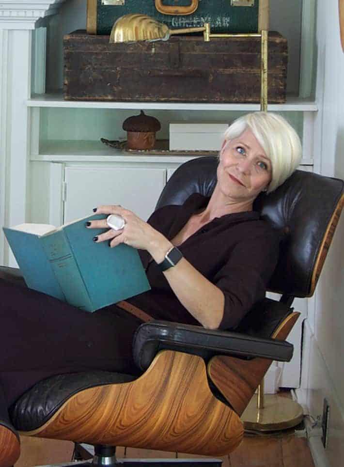 Karen Bertelsen in classic Eames chair.