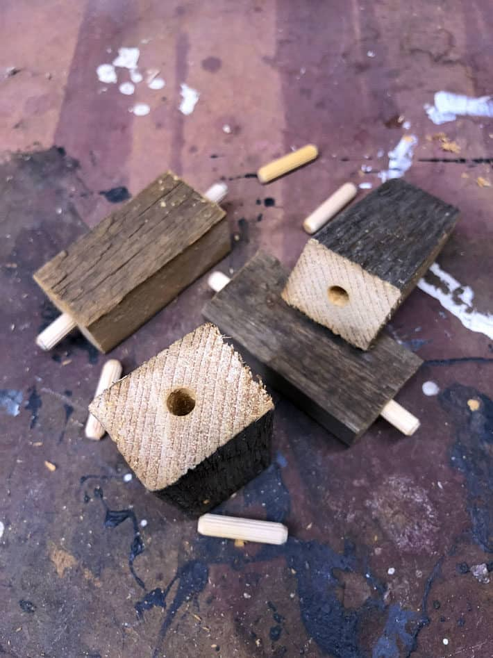 "3"" barn board blocks with holes and dowel pins in ends."